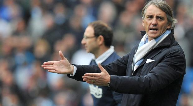 Manchester City manager Roberto Mancini has stuck with Mario Balotelli despite risking divisions in the squad