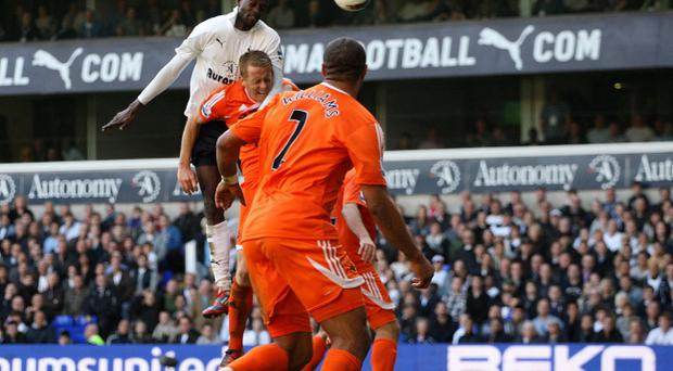 Adebayor, seen here scoring against Swansea City on Sunday, is on loan from Manchester City