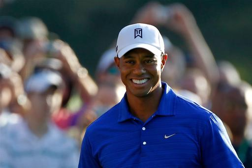 AUGUSTA, GA - APRIL 02: Tiger Woods smiles during a practice round prior to the start of the 2012 Masters Tournament at Augusta National Golf Club on April 2, 2012 in Augusta, Georgia. (Photo by Streeter Lecka/Getty Images)