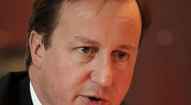 David Cameron denies that plans to monitor calls, emails, texts and website visits will be a snoopers' charter
