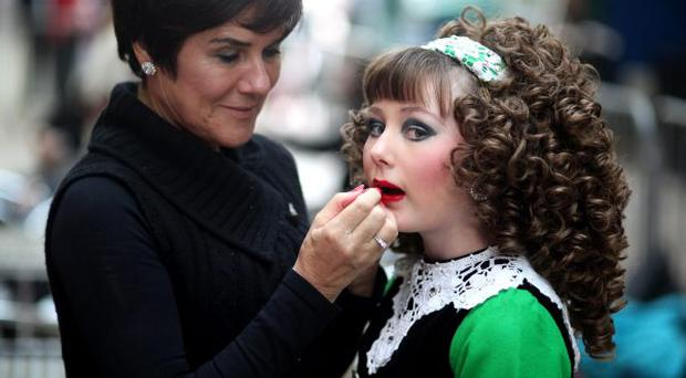 All style: an Irish dancer is made-up before competing