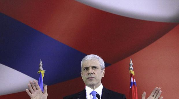 Serbia's president Boris Tadic said he is resigning, paving the way for an early presidential election (AP)