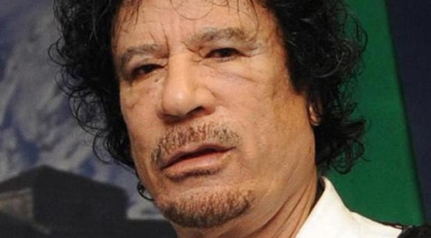 Libyan authorities must surrender the son of former dictator Muammar Gaddafi, pictured, the International Criminal Court has said