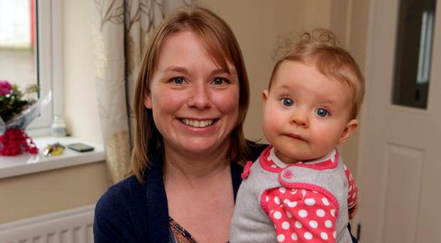 Caroline McCormick pictured at home with her 7 month old daugther Isobela.