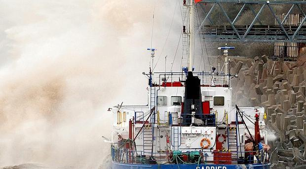 The Environment Agency are trying to remove 40,000 litres of fuel from the grounded ship
