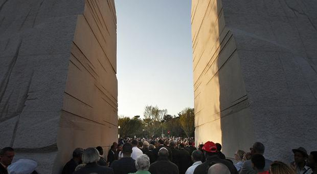 People crowd around the Martin Luther King Memorial in Washington on the 44th anniversary of his assassination (AP)
