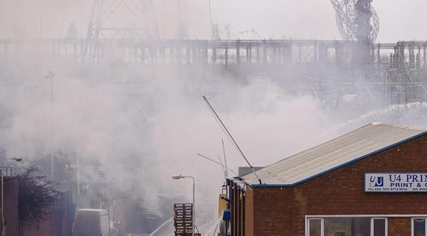 Firefighters at the scene of a blaze in Canning Town in east London