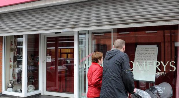 Dissapointed shoppers pictured at Montgomerys in Ballymena after the shop was closed after 82 years of trading