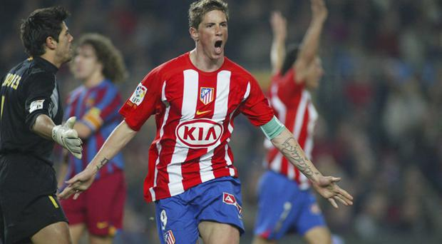 Fernando Torres of Atletico Madrid celebrates scoring during a La Liga match between FC Barcelona and Atletico Madrid, at the Camp Nou stadium on February 5, 2006