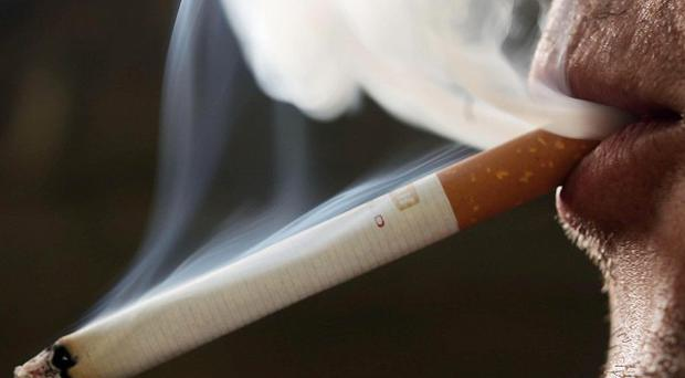 Tobacco products must be covered from public view in all large shops and supermarkets in England in a bid to prevent people smoking