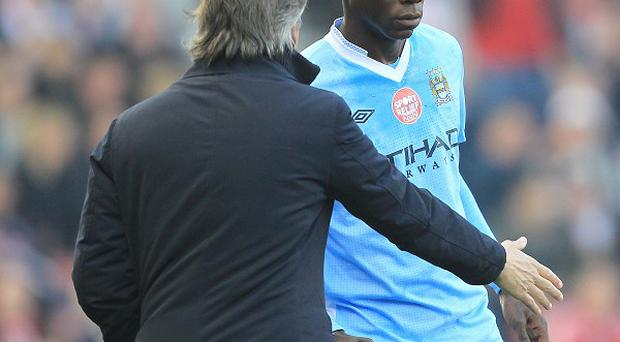 Roberto Mancini (left) and Mario Balotelli