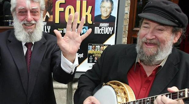 Barney McKenna, right, and Dubliners frontman Ronnie Drew outside the Gaiety Theatre in Dublin