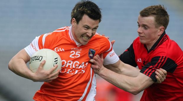 Brendan Donaghy (left) will lead Armagh's defensive resistance against Donegal on Sunday