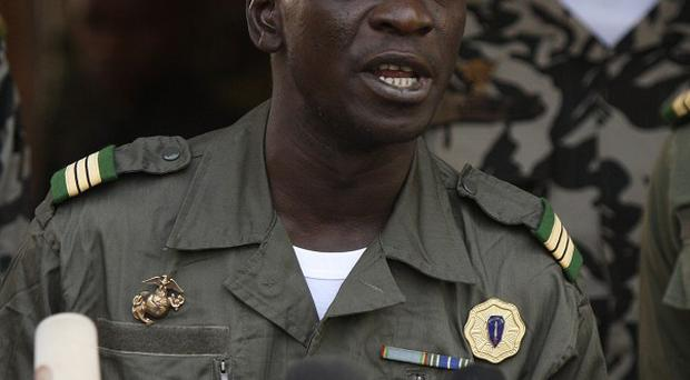 British Embassy staff in Mali are being withdrawn amid the military coup, being led by Capt. Amadou Haya Sanogo, pictured (AP)