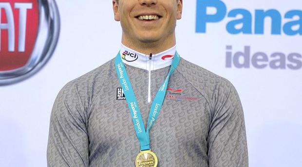The father of British cyclist Sir Chris Hoy has criticised the allocation of London 2012 tickets for families of athletes