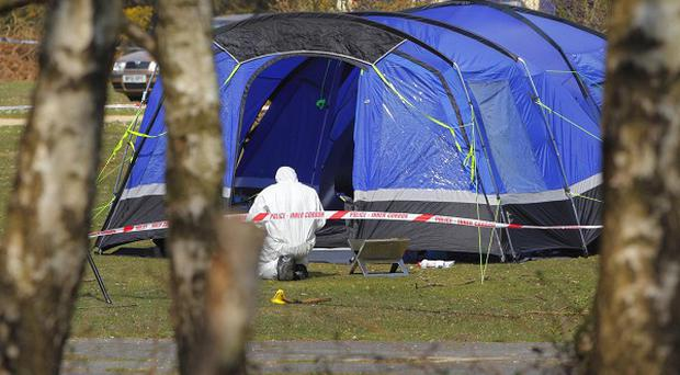 Hampshire Police forensic officers photograph the tent at the Holmsley campsite near Bransgore in the New Forest after the death of a young girl