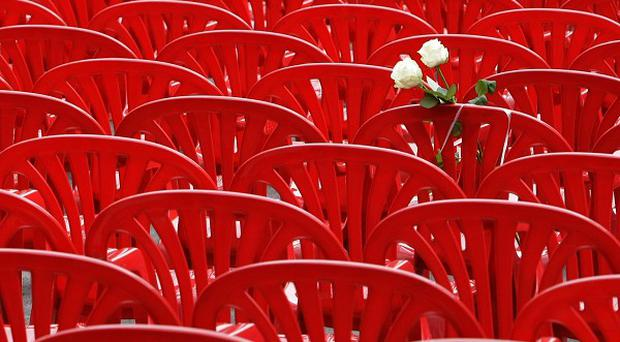 Red chairs are displayed along a main street in Sarajevo as the city marks the 20th anniversary of the start of the Bosnian war (AP Photo/Amel Emric)