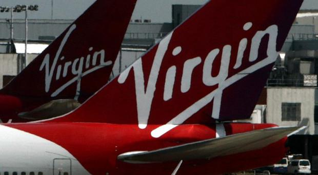 Virgin Atlantic is looking into claims an employee handed information about celebrities to a London-based paparazzi agency