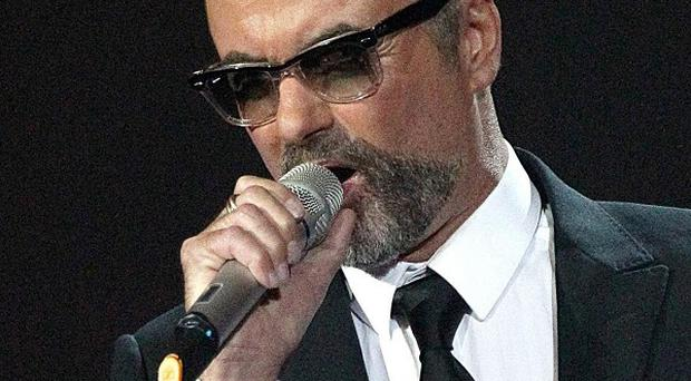 George Michael is writing White Light for the fans who prayed for his recovery