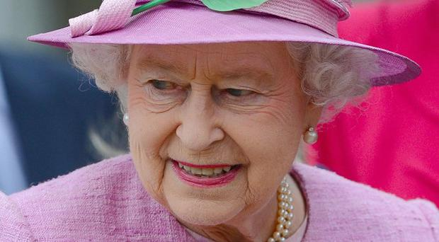 The Queen leaves Saint George's Chapel in Windsor Castle after attending the Easter Mattins service