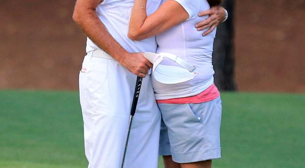 Bubba Watson hugs his mother Mollie after winning the Masters golf tournament following a sudden death playoff