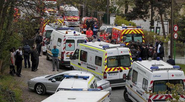 Emergency workers around the area of a building accident near Paris (AP)