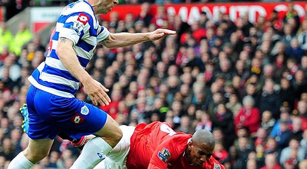 Ashley Young (right) and Shaun Derry