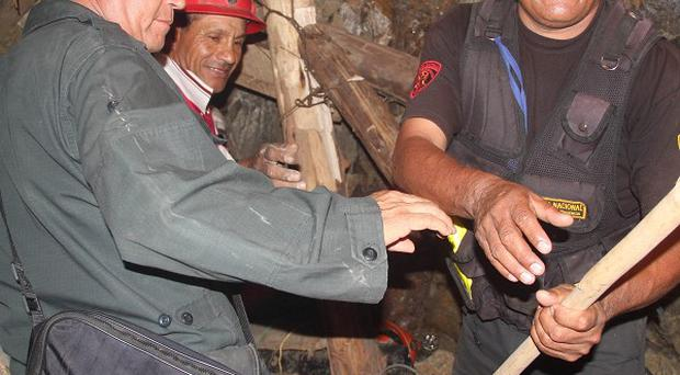 People work in a collapsed mine to rescue trapped miners in Ica, Peru (AP)