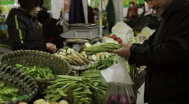 Food costs in China have risen more than a percentage point to more than seven per cent in March (AP)