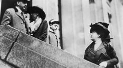Florette Guggenheim (nee Seligman 1870 - 1937, right) and her brother James de Witt Seligman at the offices of the White Star shipping line in New York, April 1912. The pair are waiting to enquire about the welfare of Guggenheim's husband, American businessman Benjamin Guggenheim, who was a passenger on board the Titanic when she sank on 15th April. Benjamin Guggenheim was not among the surviviors.