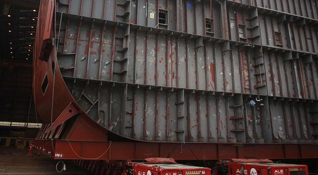 A section of the hull of HMS Queen Elizabeth is moved at BAE Systems' Govan Shipyard in Glasgow