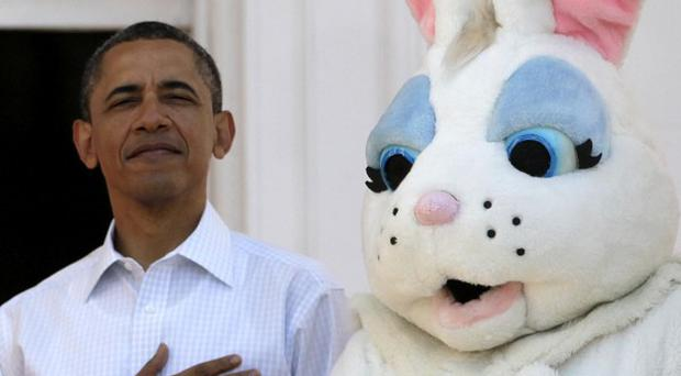 President Barack Obama stands next to the Easter Bunny during the singing of the National Anthem, at the White House (AP)