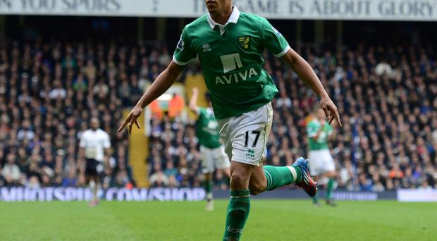 LONDON, ENGLAND - APRIL 09: Elliott Bennett of Norwich celebrates scoring their second goal during the Barclays Premier League match between Tottenham Hotspur and Norwich City at White Hart Lane on April 9, 2012 in London, England. (Photo by Shaun Botterill/Getty Images)