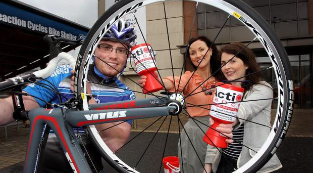 Jonny Beers from Chain Reaction Cycles launched the partnership with Action Cancer's Donna McConnell and Kerry Anderson