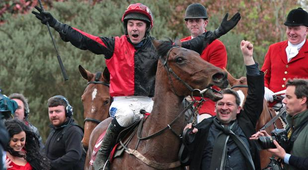 Andrew Thornton celebrates winning the Ladbrokes Irish Grand National Steeplechase on Lion Na Bearnai yesterday