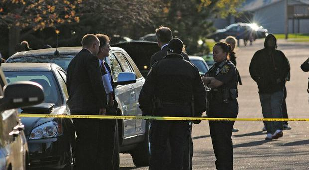 Police investigate the scene where three people were shot dead at a day care in Brooklyn Park, Minnesota (AP/The Star Tribune, Richard Sennott)