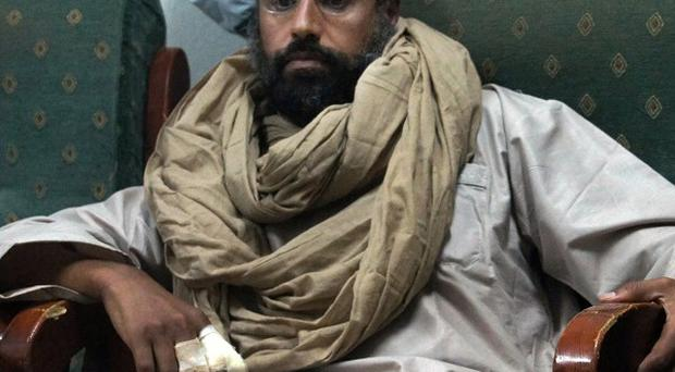 Saif al-Islam is seen after his capture in the custody of revolutionary fighters in Zintan, Libya (AP)