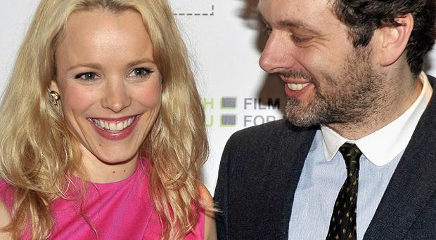 Michael Sheen (right) arrives with his partner Rachel McAdams for the premiere of The Gospel Of Us