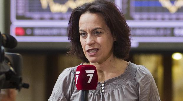 A TV journalist reports from the stock exchange in Madrid as worries about Spain's finances intensified (AP)