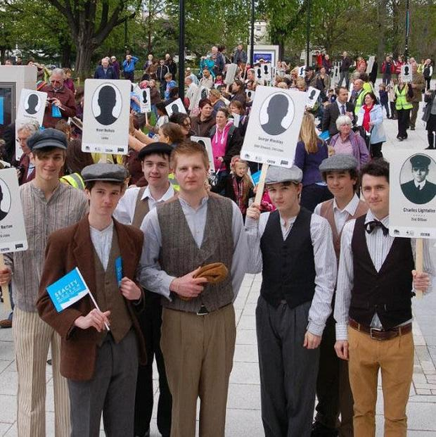 People in Southampton carry placards of all those local residents who served as crew members on the RMS Titanic
