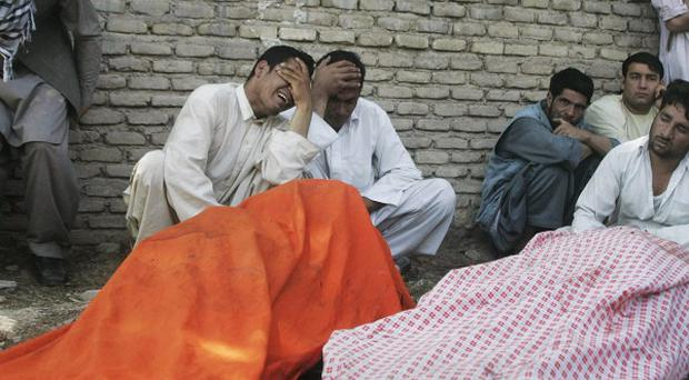 Bodies of suicide blast victims seen outside of a hospital in Herat, west of Kabul (AP)