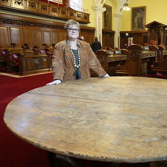 Belfast City Hall tour guide Dianne Leeman with the Covenant table, which is set to take centre stage at Belfast City Hall this year