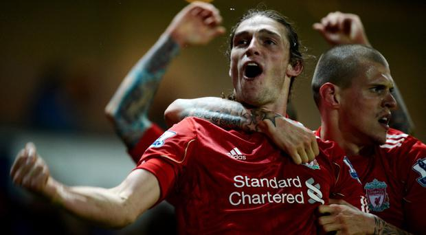 BLACKBURN, ENGLAND - APRIL 10: Andy Carroll of Liverpool celebrates scoring the winning goal with team mate Martin Skrtel (R) during the Barclays Premier League match between Blackburn Rovers and Liverpool at Ewood park on April 10, 2012 in Blackburn, England. (Photo by Laurence Griffiths/Getty Images)