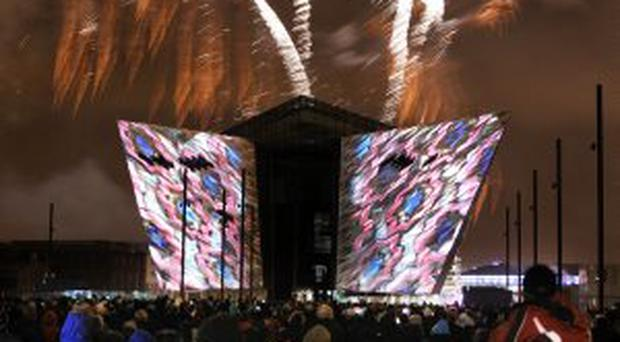 In the money: fireworks mark the launch of Titanic Belfast
