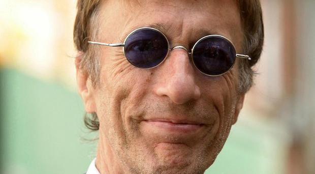 Bee Gees star Robin Gibb has missed the premiere of his first classical work due to ill health