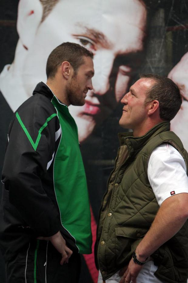 Titanic battle: Tyson Fury and Martin Rogan eyeball each other at yesterday's press conference to promote their fight at the Odyssey on Saturday