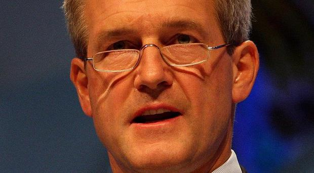Northern Ireland Secretary Owen Paterson has met with nationalists and unionists to discuss ways of dealing with the past