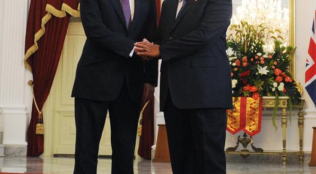 David Cameron shakes hands with Indonesian president Susilo Bambang Yudhoyono at the Presidential Palace in Jakarta