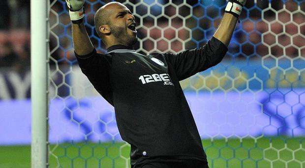 Wigan Athletic's Ali Al Habsi celebrates his teams goal against Manchester United