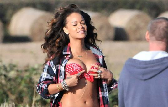 Risque Rihanna adjusts herself during a photoshoot in the Northern Ireland countryside